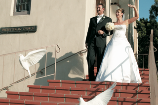 white-dove-release-as-newlyweds-leave-church-ceremony
