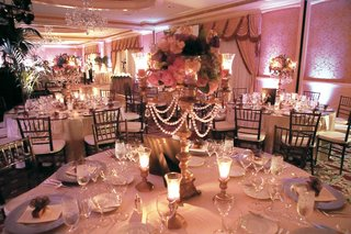 ballroom-with-pink-lighting-and-lavender-and-pink-centerpieces