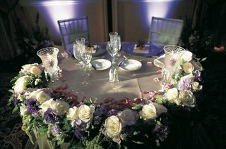 bride-and-groom-table-with-amaranthus-white-roses-and-lavender-flowers-and-crystal