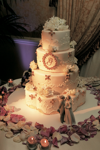 white-wedding-cake-with-purple-embellishments