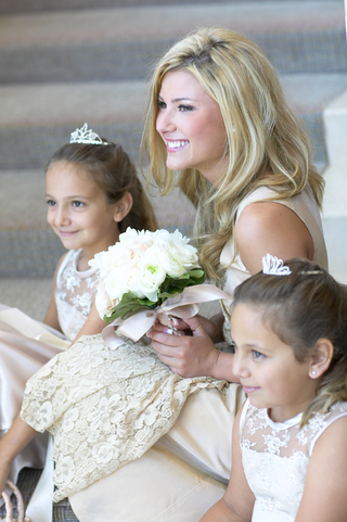 bride-sitting-on-steps-with-young-guests