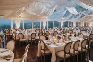 tent-wedding-with-french-oval-chairs-drapery-patio-lights-low-centerpieces