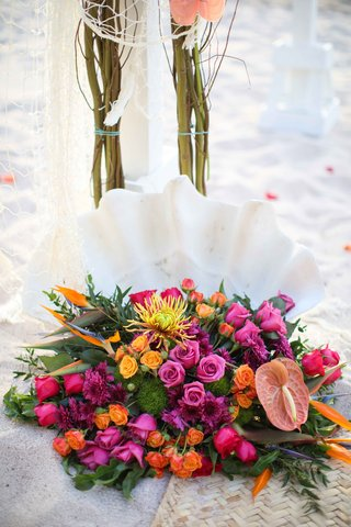 bright-colorful-floral-arrangement-sand-beach-destination-wedding-mexico-pink-orange-yellow-green