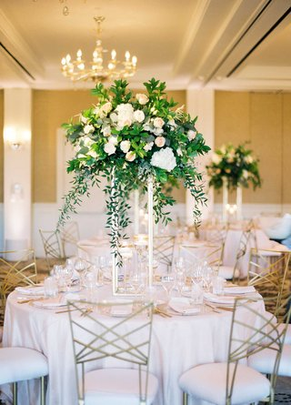 wedding-reception-light-pink-linens-metallic-chairs-tall-centerpiece-with-greenery-white-pink-flower