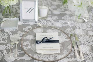 white-lace-table-linen-and-clear-glass-plate-with-white-and-gray-placecard-reception