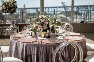 wedding-reception-greenery-pink-purple-flowers-velvet-round-table-clear-acrylic-chairs-lucite