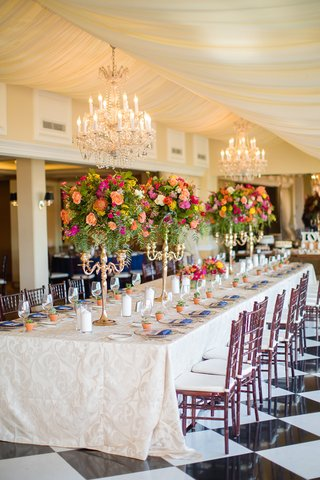 colorful-long-tablescape-tall-centerpieces-yellow-salmon-pink-orange-candelabra-wedding-la-valencia