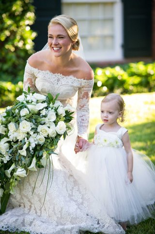 bride-in-off-the-shoulder-long-sleeve-lace-isabelle-armstrong-wedding-dress-with-flower-girl