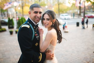 wedding-couple-portrait-groom-in-military-uniform-bride-in-strapless-gown-ponytail-hairstyle