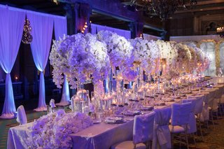 wedding-reception-drapery-long-table-with-runner-and-tall-centerpieces-white-orchid-flowers