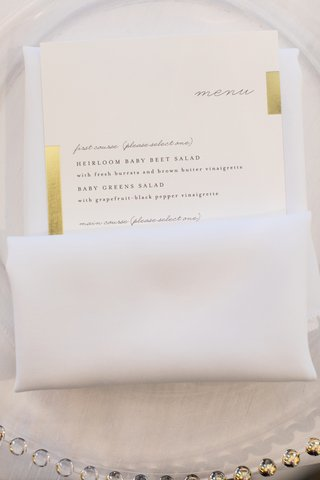 wedding-menu-tucked-into-napkin-with-accents-of-gold-on-border