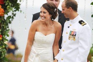 bride-in-strapless-wedding-dress-and-navy-groom-in-white-uniform