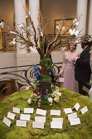 escort-card-table-tree-moss-flowers-dayton-ohio-wedding-reception-art-institute-garden-indoor-unique
