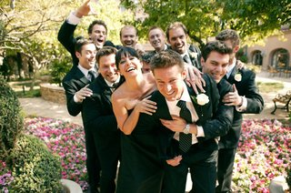 fun-portrait-of-groom-and-wedding-party