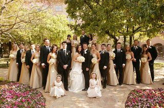 bridesmaids-in-gold-and-groomsmen-in-tuxedos
