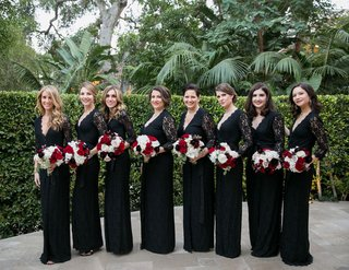 bridesmaids-in-black-long-sleeve-v-neck-lace-bridesmaid-dresses-carrying-red-and-white-bouquets