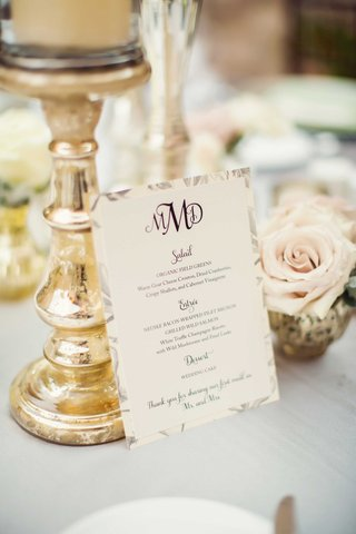 wedding-menu-on-reception-table-with-three-initial-wedding-monogram-and-gold-candle-riser-mercury