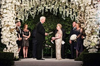 wedding-ceremony-vow-renewal-white-flowers-orchids-roses-chuppah-greenery-chandelier-vow-renewal