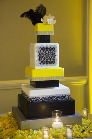 black-yellow-and-silver-wedding-cake-with-ostrich-feathers