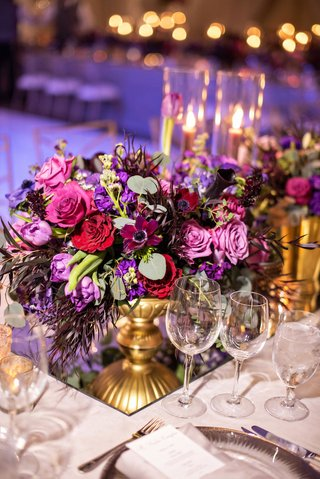 wedding-reception-purple-lighting-mirror-with-gold-footed-vase-pink-purple-rose-flowers-greenery