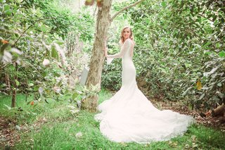 bride-in-a-pronovias-lace-fit-and-flare-gown-with-long-sleeves-tulle-train-eden-gardens-ca
