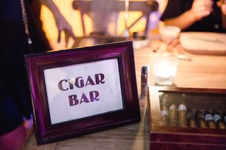 sign-with-cigar-bar-in-frame-next-to-cigars-mexico-wedding-reception
