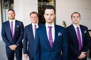 groom-with-men-in-navy-suits-with-polka-dot-tie
