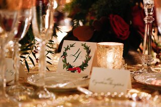 red-and-green-holly-wreath-design-with-calligraphy-number-on-table-card