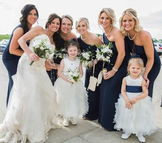 bride-in-maggie-sottero-wedding-dress-with-navy-blue-bridesmaids-and-two-flower-girls