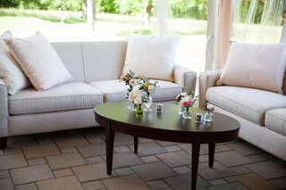 comfortable-lounge-area-with-white-couches-and-simplistic-detailing-in-outside-tented-space