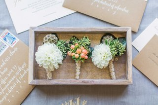 rustic-wedding-boutonniere-ideas-white-dahlia-scabiosa-pods-and-greenery-with-berries