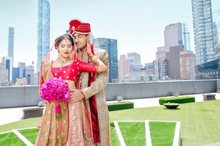 indian-american-couple-in-traditional-wedding-attire-in-front-of-new-york-skyline