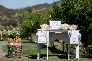 stations-with-rose-petals-for-guests-to-toss-during-bride-and-groom-exit