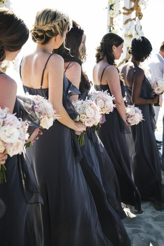 bridesmaids-in-floor-length-gowns-at-beach-ceremony