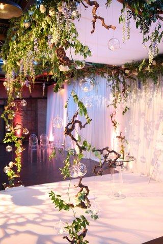 wedding ceremony industrial venue manzanita branches glass orb ghost chairs greenery blue delphinium
