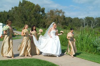 bride-and-bridesmaids-walking-to-ceremony