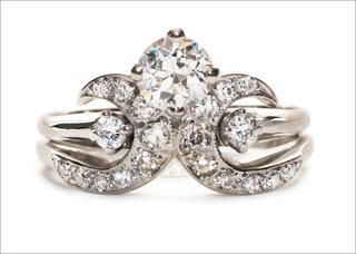 1940s-chapel-ring-in-14k-white-gold-featuring-a-0-55ct-old-european-cut-diamond-with-pave-set-and