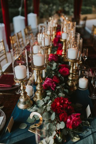 wedding-kings-table-red-floral-garland-runner-candles-on-gold-stands