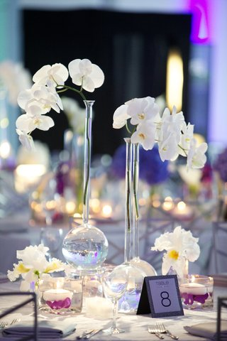 long-neck-vase-with-orchids-at-round-reception-table