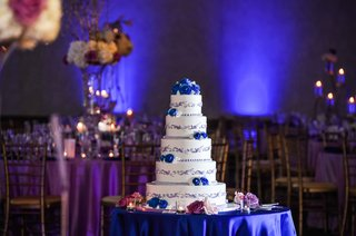 five-tier-wedding-cake-featured-frosted-blues-flowers-with-grayish-lavender-detail