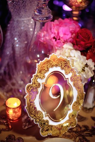 glam-wedding-reception-pink-red-purple-color-palette-gold-ornate-design-cut-out-mirror-laser-cut