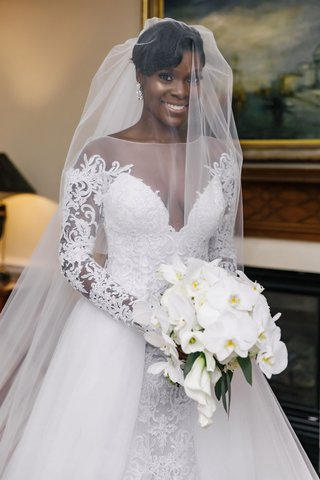 bride-in-illusion-neckline-long-sleeve-a-line-wedding-dress-overskirt-white-orchid-bouquet-veil