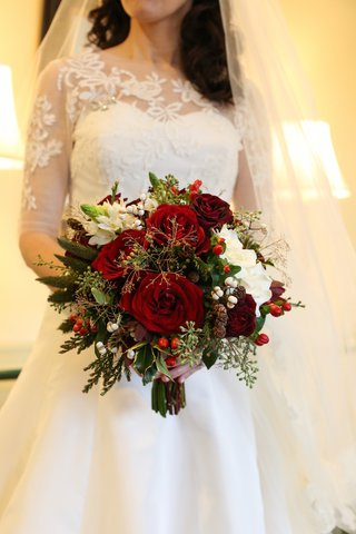 red-and-green-wedding-bouquet-with-miniature-pinecones-greenery-and-red-berries