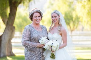 bride-in-a-strapless-hayley-paige-dress-veil-with-mother-in-a-silver-soulmates-outfit