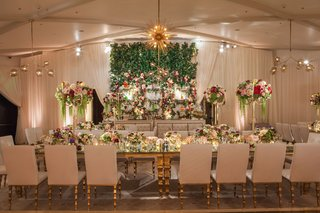 wedding-reception-with-white-gold-furniture-and-flowers-in-green-red-burgundy-pink-white-flower-wall