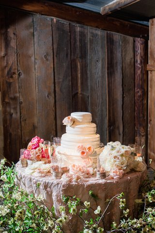 rustic-reception-space-with-floral-cake-table