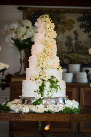 six-tier-white-wedding-cake-with-fresh-cascading-rose-and-orchid-flowers
