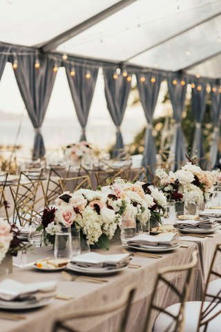 wedding-reception-neutral-linens-low-centerpiece-white-blush-burgundy-grey-drapes-string-lights