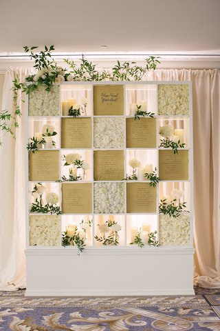 wedding-reception-seating-chart-square-bookcase-paper-seating-chart-white-roses-flowers-candles