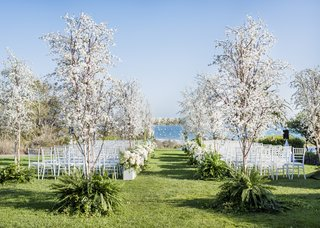 santa-barbara-wedding-ocean-view-ceremony-white-flowers-trees-in-ferns